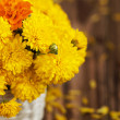 Beautiful bouquet of yellow chrysanthemums flowers in wicker ba — Stock Photo #55148049