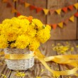 Beautiful bouquet of yellow chrysanthemums flowers in wicker ba — Stock Photo #55148911