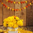 Beautiful bouquet of yellow chrysanthemums flowers in wicker ba — Stock Photo #55151001