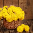 Beautiful bouquet of yellow chrysanthemums flowers in wicker ba — Stock Photo #55153809