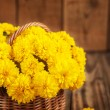 Beautiful bouquet of yellow chrysanthemums flowers in wicker ba — Stock Photo #55154631