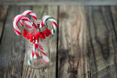 Christmas sweet candys in the glass on the wood background — Stock Photo