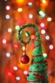 Handmade Christmas tree decoration against lights blurred backg — Stock Photo