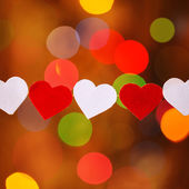 Garland with Red and white hearts  on boke background — Stock Photo