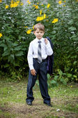 Portrait of little businessman on nature — Stock Photo