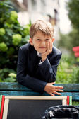 Portrait of a school boy in the green park — Stock Photo