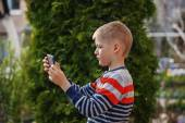 Little boy in nature with tablet, outdoor portrait — Stock Photo