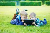Siblings using a tablet — Stock Photo