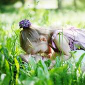 Happy family. Mother and  daughter lie on a grass, embrace  in t — Stock Photo