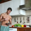 Sexy man eating his breakfast — Stock Photo #59973805