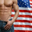 Muscular Male Torso with US Flag behind — Stock Photo #59974299