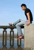 Young Man at the Embankment — Stock Photo