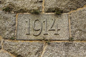 Year 1914 carved in the stone. — Stock Photo