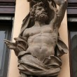 Постер, плакат: Muscular atlas supporting a Baroque building