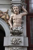 Muscular atlas supported a Renaissance house — Stock Photo