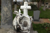Destroyed tombstone at cemetery. — Stock Photo