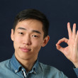 Asian man giving okay sign — Stock Photo #69293109
