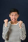 Displeased young Asian man — Stock Photo
