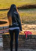 Back View of Young Woman Upstanding at Park — Stock Photo