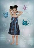 Girl and small fishes — Stock Photo