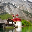 Beautiful Alpine scenery - crystal lake Koenigsee with church — Photo #51870371
