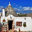 Unique Trulli houses with conical roofs in Alberobello, Italy — Stock Photo #58442523