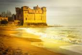 Golden castle. Castle Santa severa ocer sunset. Italy — Stock Photo