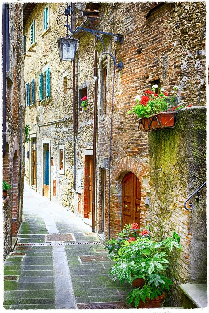 Charming old streets of medieval towns of Italy — Stock Photo © Maugli #65636489