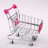 Shopping cart on white background — Stock Photo