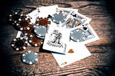 Cards with joker and counters — Stock Photo
