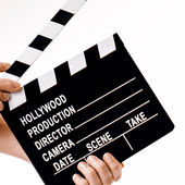 Movie flapper in woman hands on white background — Stock Photo