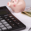 Business Charts with calculator, money, piggy box and pen — Stock Photo #57771071