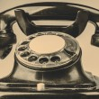 Old black phone with dust and scratches on white background — Stock Photo #57994371
