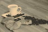 Coffee cup and saucer on a wooden table — Stock Photo