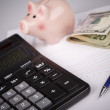Business Charts with calculator, money, piggy box and pen — Stock Photo #58569267