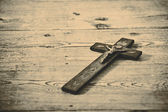 Old cross with jesus on the old floor — Stock Photo