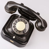 Old black phone with dust and scratches on white background — Stock Photo