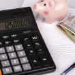 Business Charts with calculator, money, piggy box and pen — Stock Photo #61587757