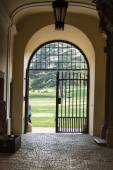 Old passage or gateway to the green park — Stock Photo