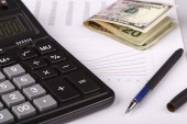 Business Charts with calculator, money and pen — Stock Photo