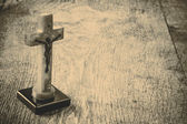Beautiful old cross with jesus on the old wooden floor — Stock Photo