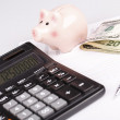 Business Charts with calculator, money, piggy box and pen — Stock Photo #63338933