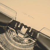 Old typewriter with text join us — Stock fotografie