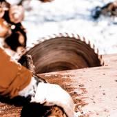 Man working with circular saw blade — Stock Photo
