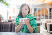 Happy Woman holding a cup of coffee — Stock Photo