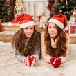 Two little girls in Christmas background — Stock Photo #60415429