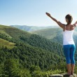 Young woman meditate on the top of mountain — Stock Photo #67056497