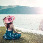 Woman meditating at the sea — Stock Photo