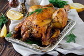 Chicken baked with lemon and spices — Stock Photo