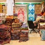 Vintage textiles and carpets shops, Mutrah Souk, Muscat, Oman — Stock Photo #65281653
